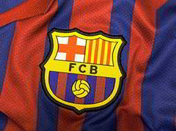 The FC Barcelona badge on a football shirt