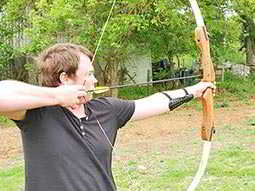 A man firing an arrow from a bow