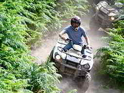 A man driving a quad bike