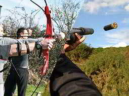 A split image of men firing bows and arrows, and shooting bullets at clays