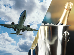 Men pouring beer from a wooden barrel with people looking on in the background