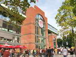 People stood outside the exterior of the St Pauli stadium during the day