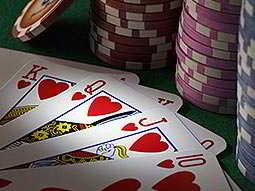 A deck of cards in front of poker chips