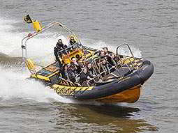 O2 RIB boat travelling along The Thames