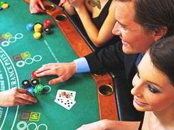 A group of people at a blackjack table