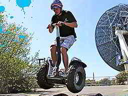 A man riding on a Segway outdoors