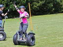 A woman driving a Segway on grass