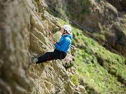 Close up of a man abseiling down a cliff