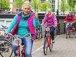 Some women riding bicycles in Amsterdam