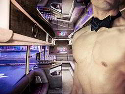 The interior of a party bus overlaid with a topless man wearing a bow-tie
