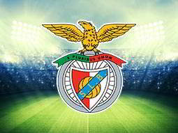Benfica football logo over a faded image of the pitch and seating at the Estadio da Luz