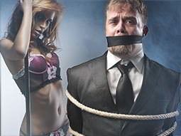 A split image of a woman in pink and black lingerie and a man in a suit tied up with a gag over his mouth