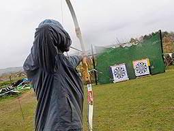 A man firing an arrow at two targets