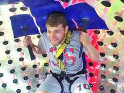 Man smiling whilst strapped into a zorb