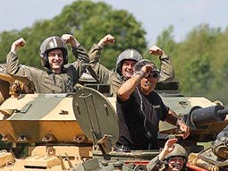 Four people in a tank, riding into battle
