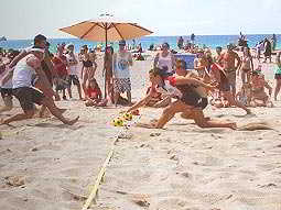 People playing sports on the beach
