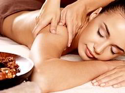 A woman receiving a massage in a spa