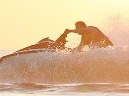 A man riding a jet ski on the sea
