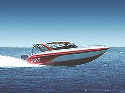 A speedboat driving across the ocean