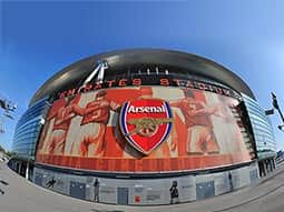 The Arsenal badge on the side of the Emirates Stadium