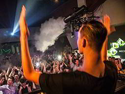 A man performing to a huge crowd at Mecca club in Prague
