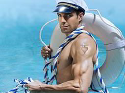 A male stripper dressed as a sailor, carrying a life buoy