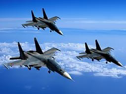 Three military planes flying in the sky