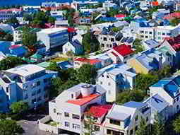 A view over white buildings with coloured roofs