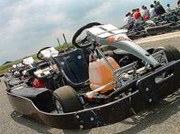 A go kart parked up on a track outdoors