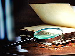 A magnifying glass lying out on a book