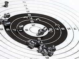 Empty bullets on a paper shooting target