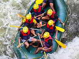 Birds eye view of people in a dinghy on a river
