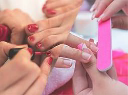 A split image of a woman getting a manicure and a pedicure