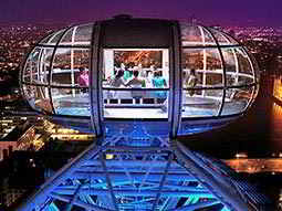 London Eye viewing pod, to a backdrop of the city illuminated at night