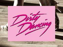 Pink Dirty Dancing test on a pink background, over a close up image of a man and womans feet as they dance