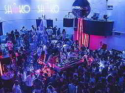 People dancing in Shoko to a backdrop of blue light