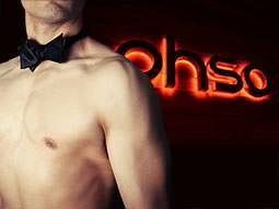 An illuminated 'Ohso' sign overlaid with a topless man wearing a bowtie