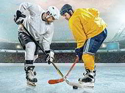Two men playing ice hockey, with an arena in the background