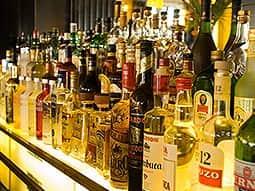 A line of spirit bottles on a bar top