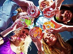 Five girls holding their drinks in the middle of their group