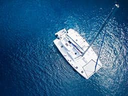 A bird's eye view of a yacht on the sea