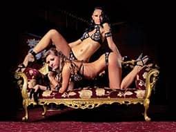 Two women in underwear posing on a seat