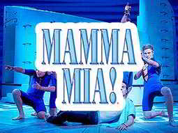 Actors on stage behind the logo for Mamma Mia musical