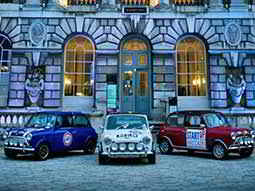Red, White and Blue Mini Coopers outside a building in London