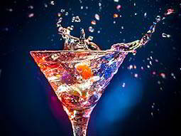 Splashes flying from exotic colourful cocktail