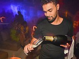A man pouring Moet into a champagne flute