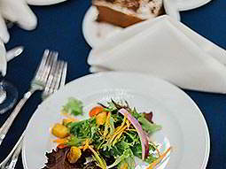 A small plate of food on a blue tablecloth