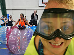 A group of women posing on their inflated zorbs