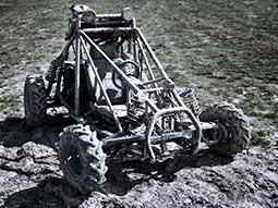A stationary rage buggy in a field