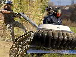 Split image of a man driving a DTV Shredder and a man driving a hovercraft in a field